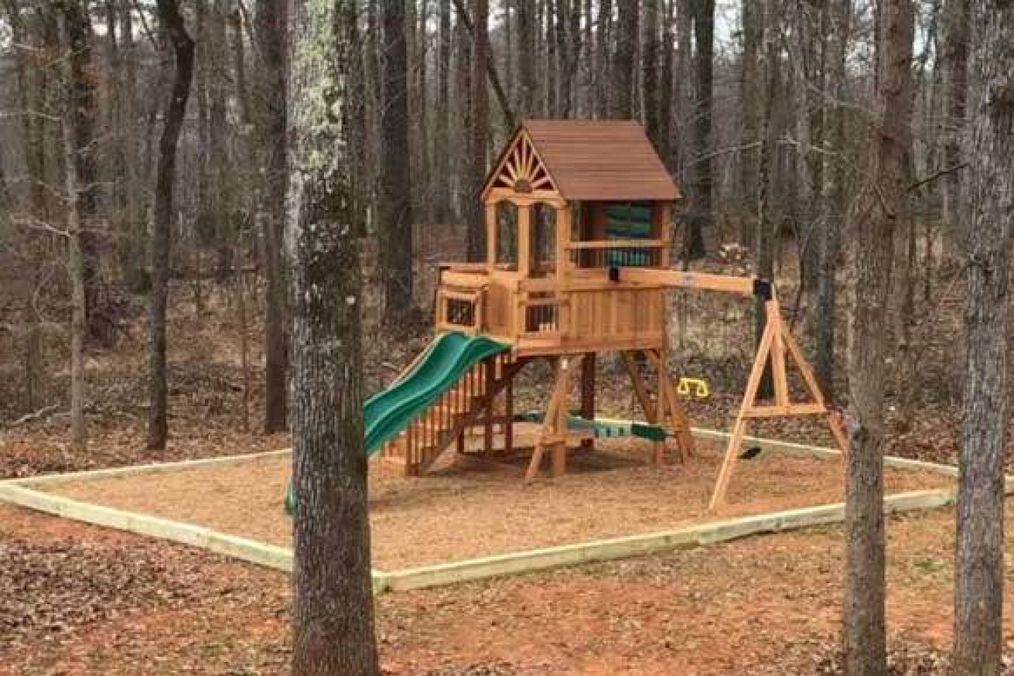Playground set on a landscaped yard